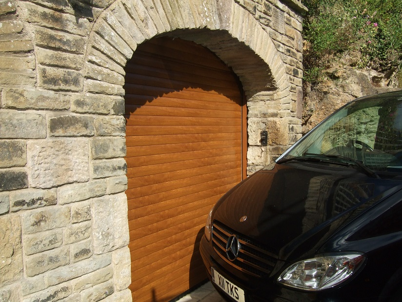 Woodgrain Golden Oak Roller Garage Door - Arrow Security Shutters Limited